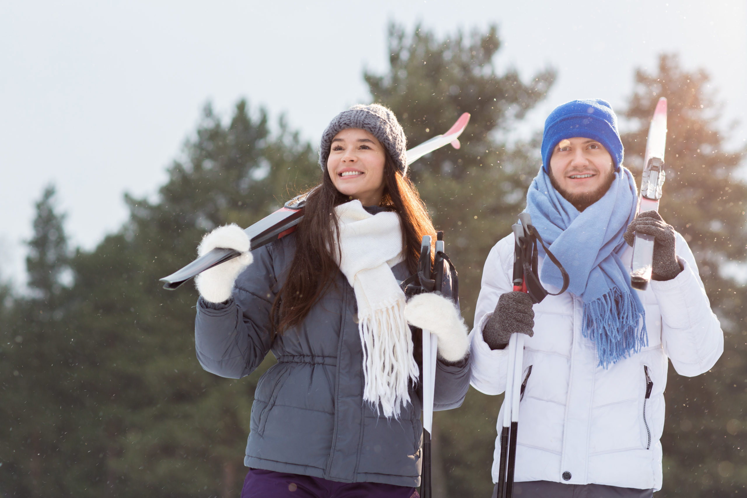 A man and woman with ski equipment